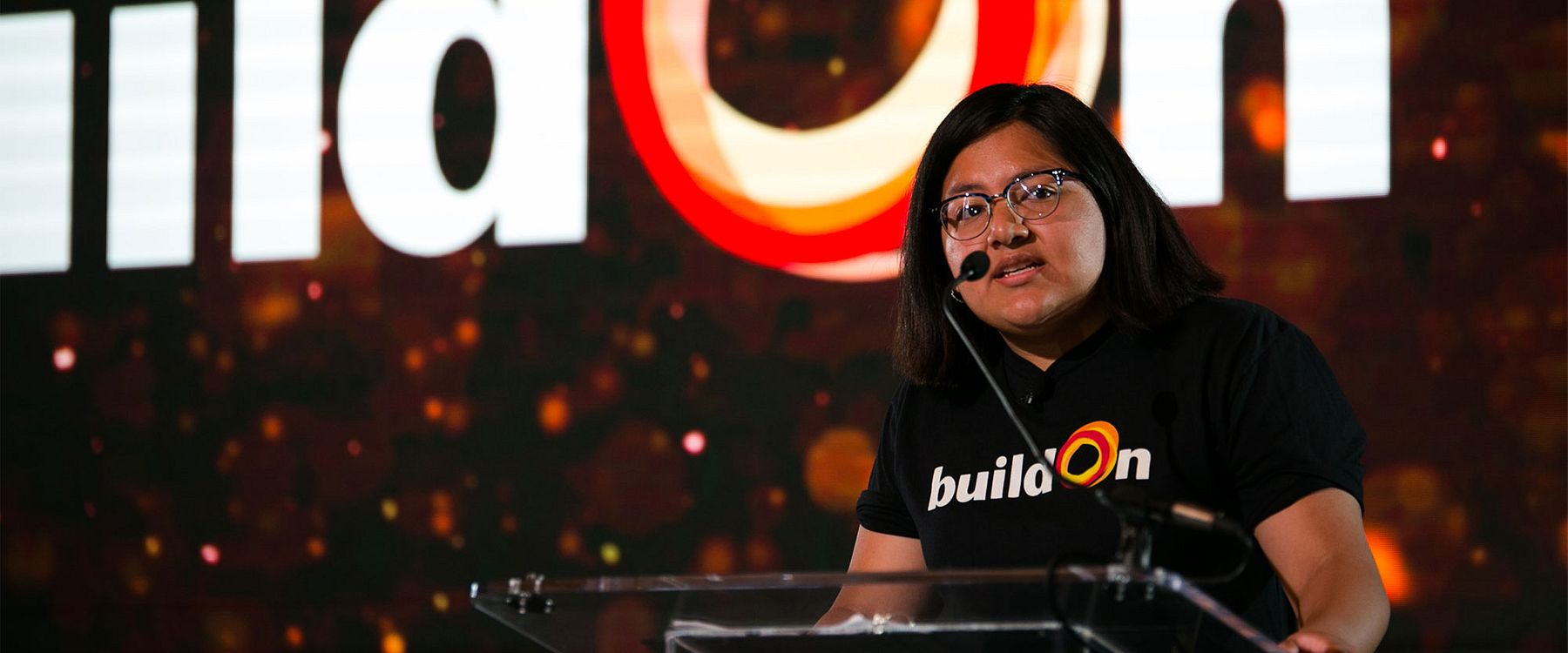 Cris, a buildOn student from Gage Park, shares their story from the stage at the buildOn Chicago Breakfast.