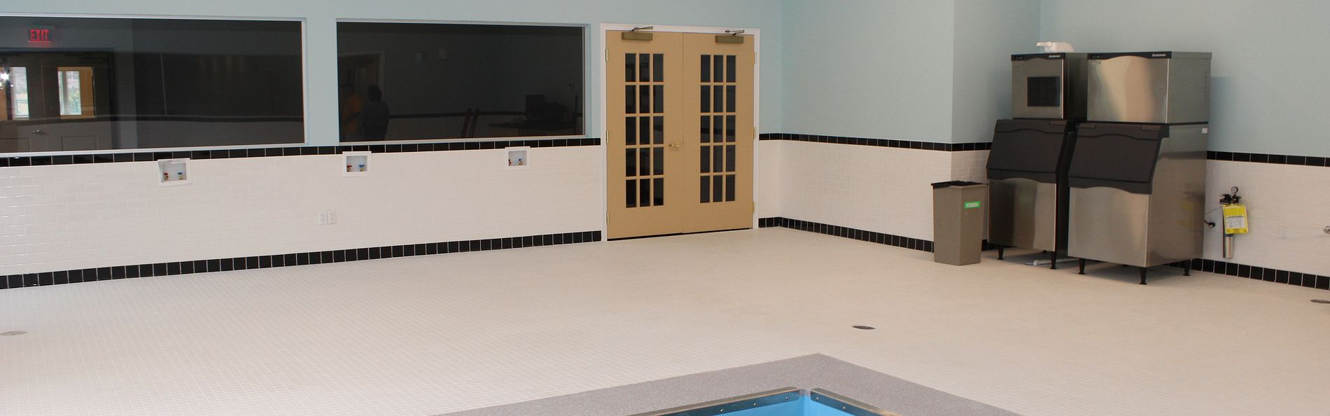The facility includes a physical therapy suite, NFL weight and locker rooms, and a large hydro-pool
