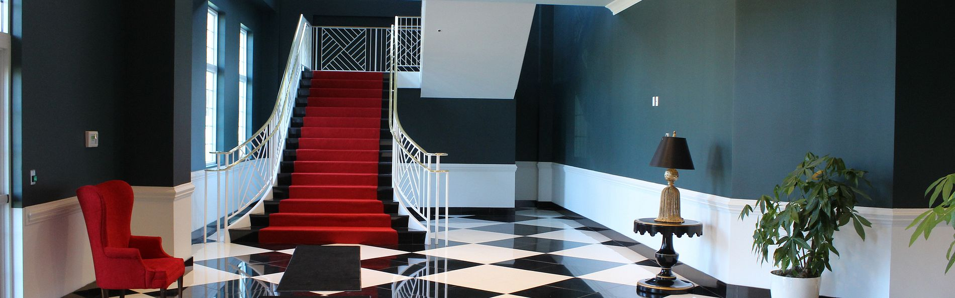 Red stair case with checkered flooring in the Greenbrier