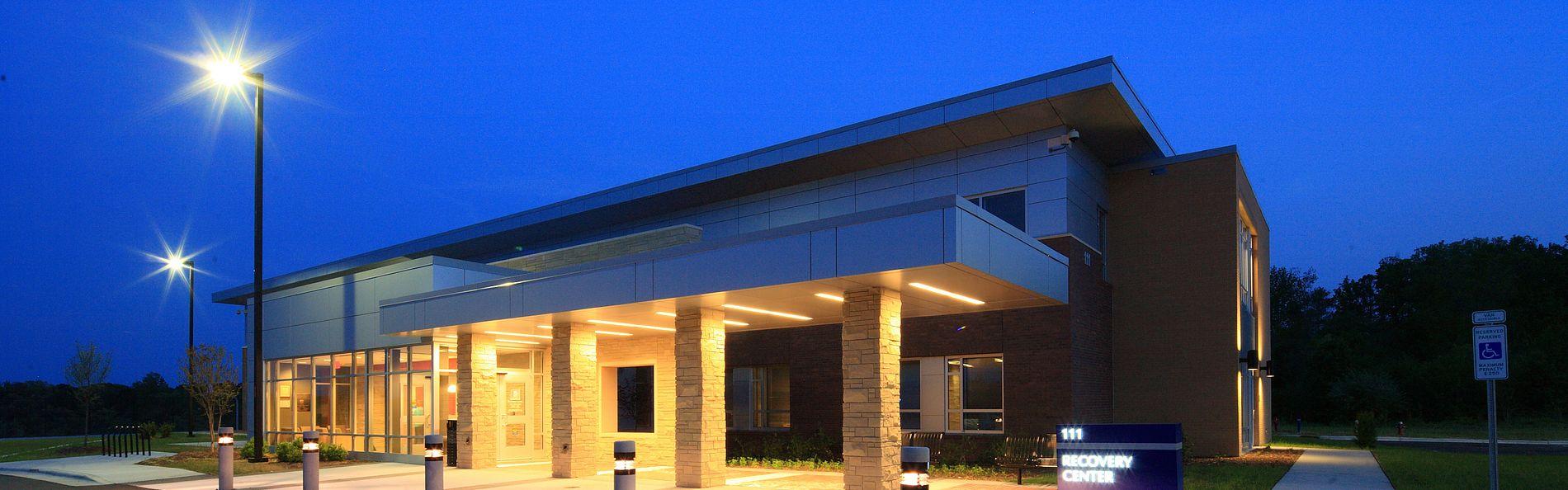 The exterior of both buildings is brick veneer, ashlar stone veneer, and metal wall panels
