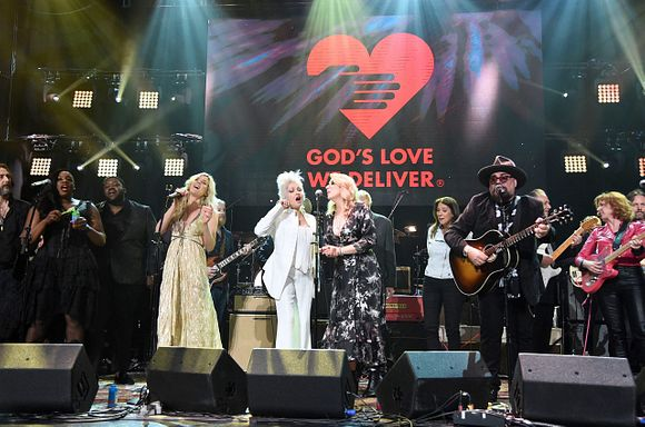 Chris Robinson, Tanya Blount-Trotter, Michael Trotter Jr, Joss Sone, Cyndi Lauper, Susan Tedeschi Karen Pearl, Jimmy Vivino and Sue Foley perform the finale on stage during the Fourth Annual LOVE ROCKS NYC benefit concert for God's Love We Deliver at Beacon Theatre on March 12, 2020 in New York City