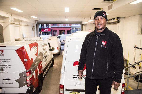 Driver Freddie in front of vans