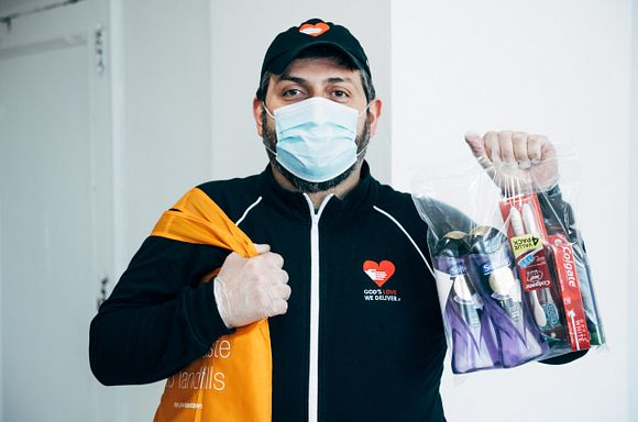 Onnik Holds products donated by Colgate-Palmolive