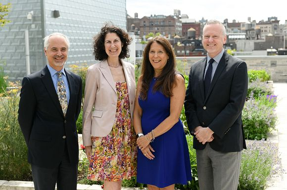 God's Love Executive Team Members Michael Tuccillo, Marla Hassner, Karen Pearl, and David Ludwigson standing in the rooftop herb garden