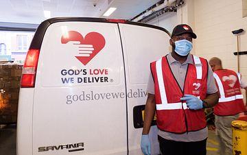 Staff driver Matthew in front of his van