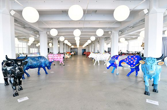 A view of painted cows on display at the CowParade 2021 launch event hosted by God's Love We Deliver at the Artist Studio sponsored by CLEAR in Industry City on August 5, 2021 in Brooklyn, NY