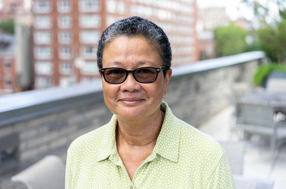 Headshot of Elaine Kiang, taken on the terrace of God's Love