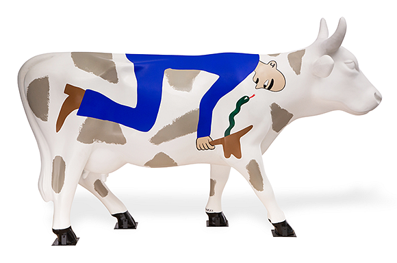 Right facing cow mainly white with putty color spots on the back and legs. Half side of a bald man with dark eyebrow dressed in blue with a brown boot holding a brown cowboy hat with a green red tongue snake facing his nose.