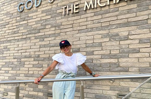 Sarah Sclarandis, donor, in front of The Michael Kors Building