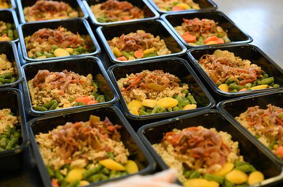 Photo of many ground chicken stir fry meals lined up in the kitchen.