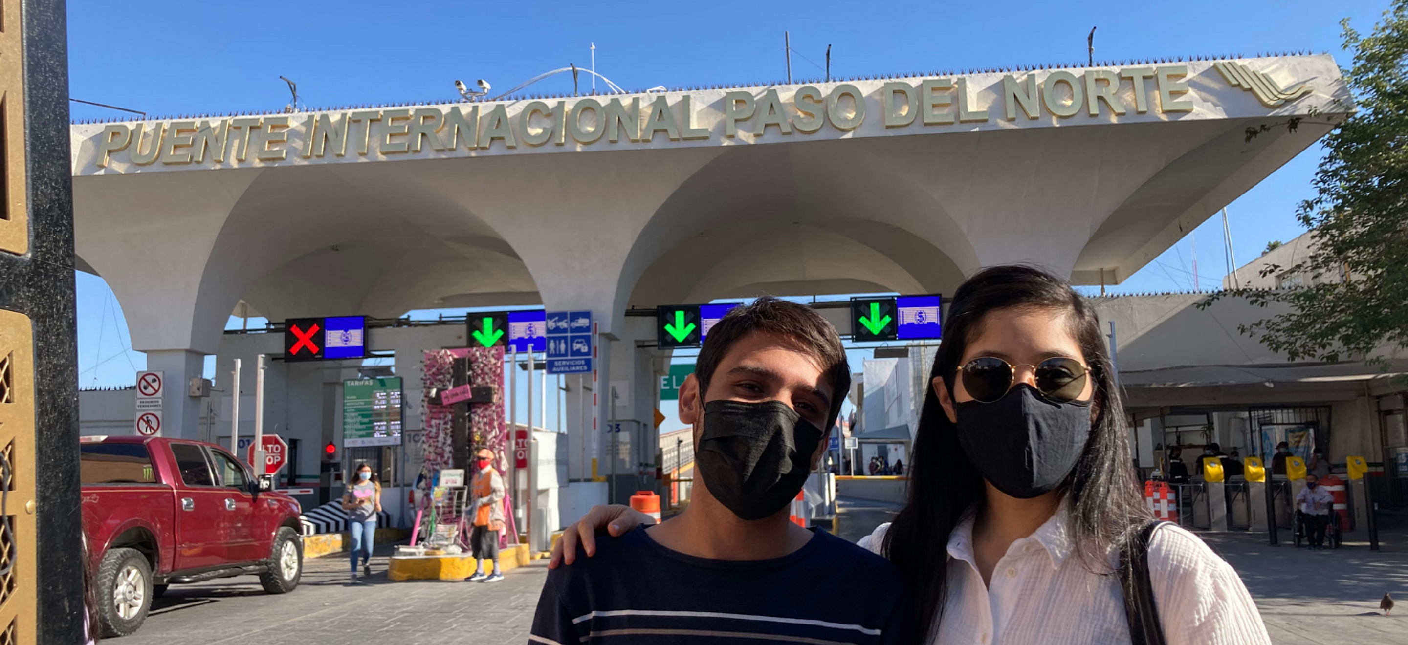 IRAP staff member Lily Fajardo and CLINIC partner Victor Flores stand in front of the Ciudad Juarez / El Paso port of entry.