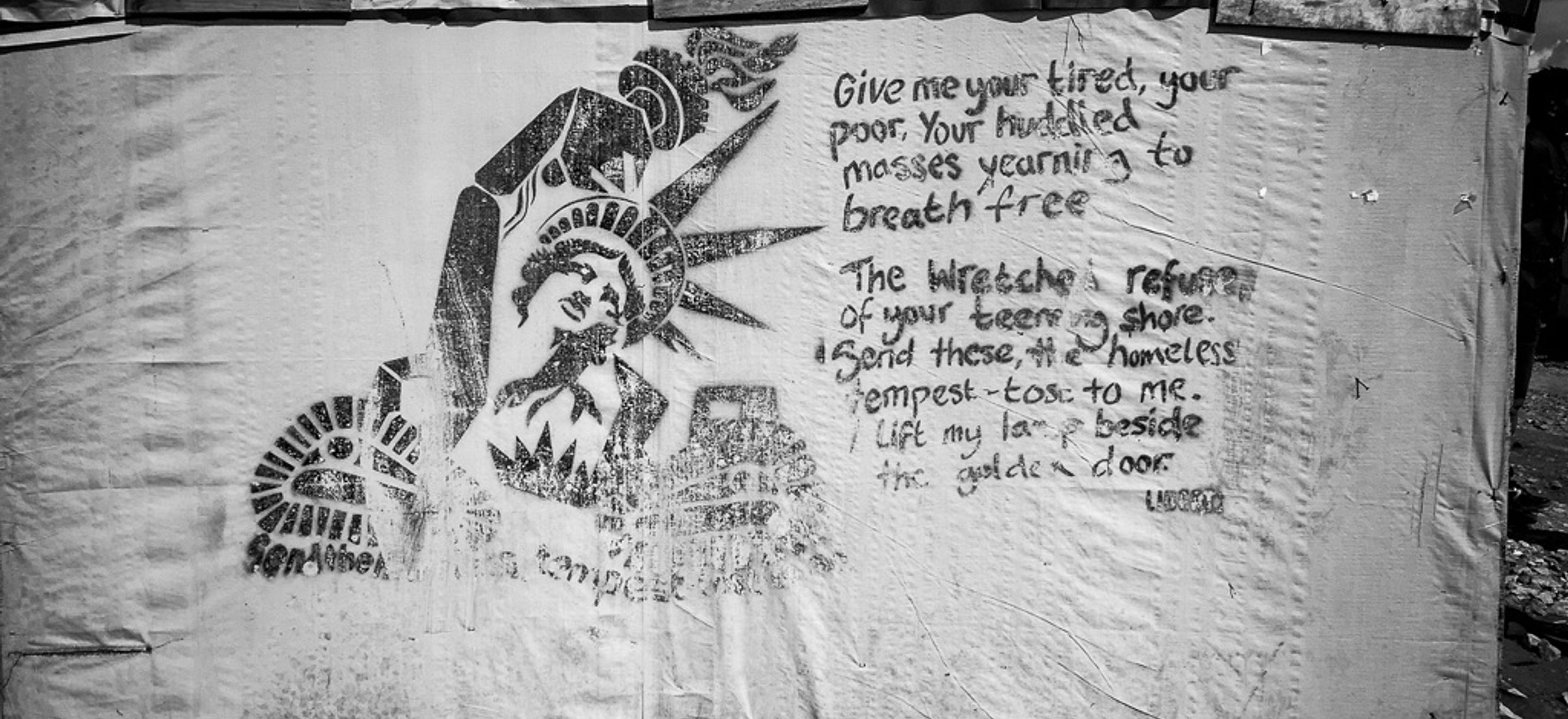 "Stenciled artwork of the Statue of Liberty sprayed onto a piece of canvas-like fabric. A portion of Emma Lazarus's poem ""The New Colossus"" are also painted on the fabric - ""Give me your tired, your poor, Your huddled masses yearning to breathe free, The wretched refuse of your teeming shore. Send these, the homeless, tempest-tost to me, I lift my lamp beside the golden door!"""