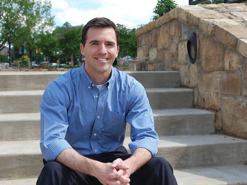 Senator Jackson seated on outdoor stairs
