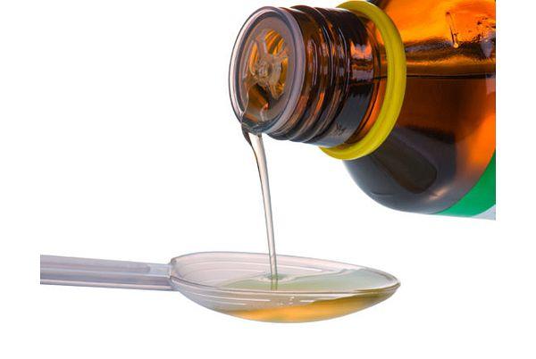 Medicine Syrup in Dose Spoon