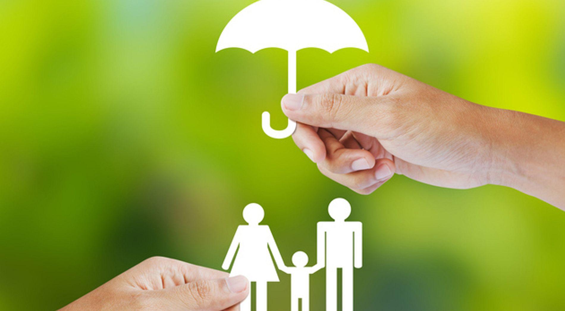Stick figure family under an umbrella