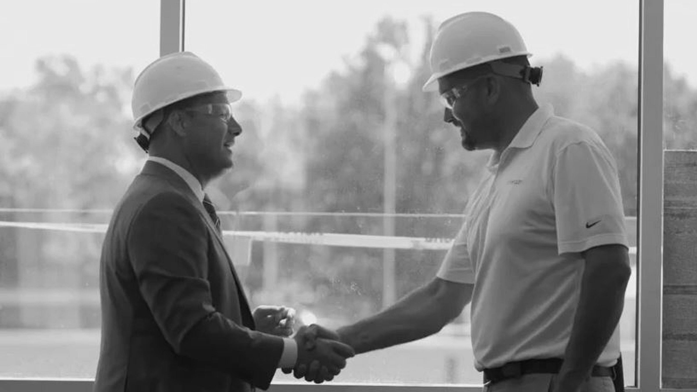 Men shaking hands on a construction site