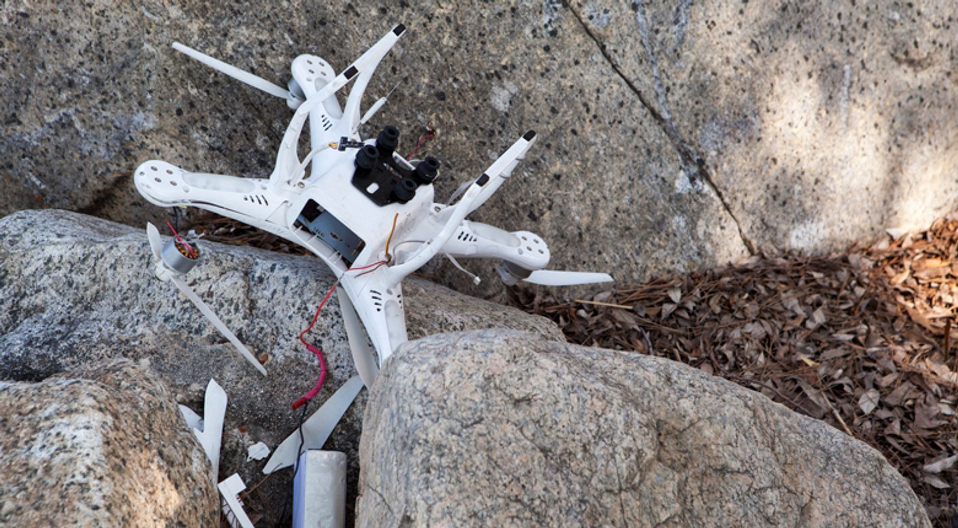 Crashed drone laying on rocks