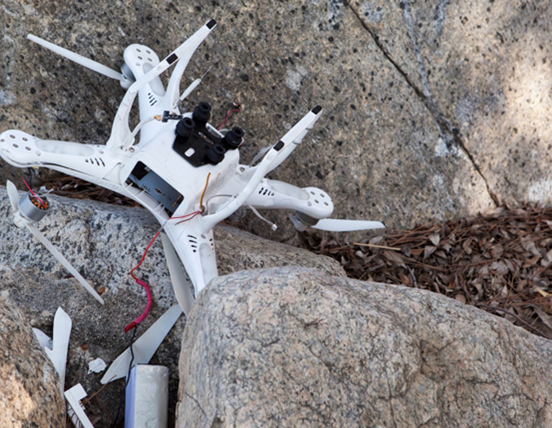 Crashed drone laying on rocks