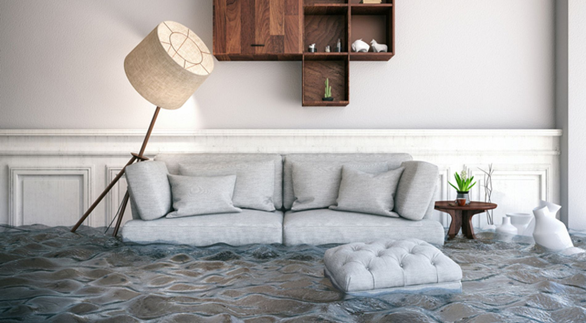 Living room flooded with water and floating furniture