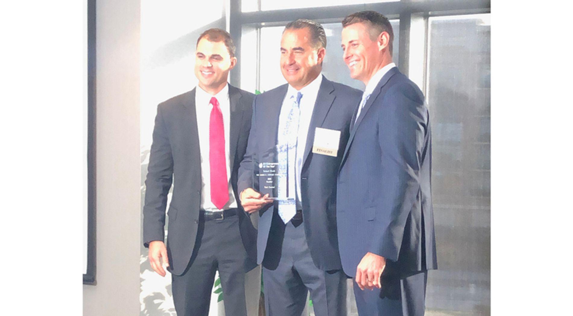 Bob Klonk of Oswald Companies receiving an award