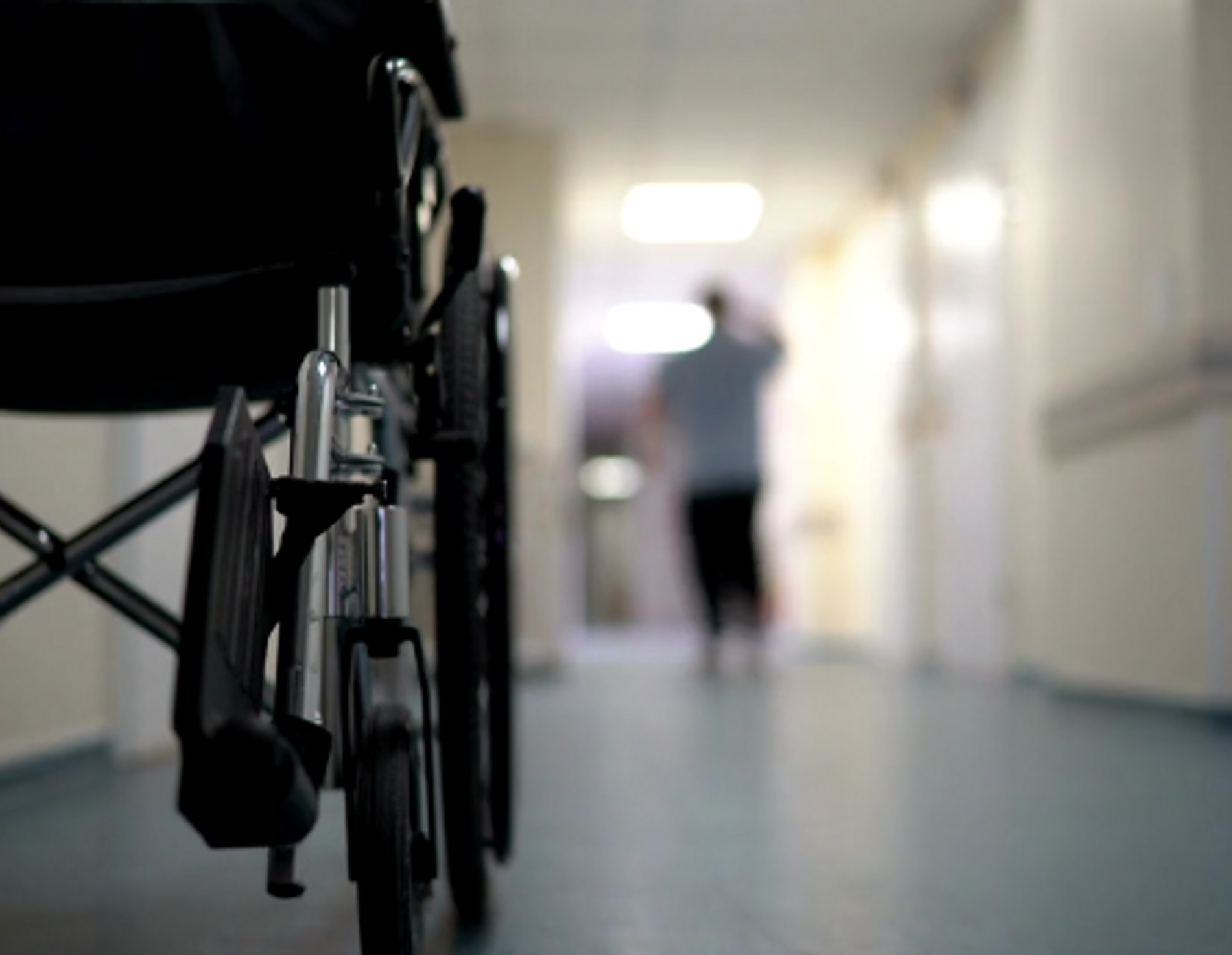 Empty wheelchair sitting in a hallway