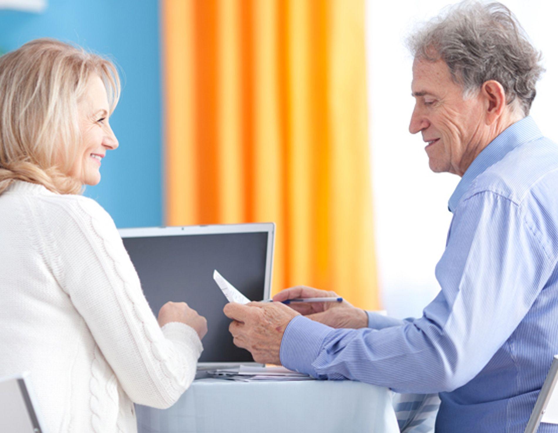 Older couple paying bills.