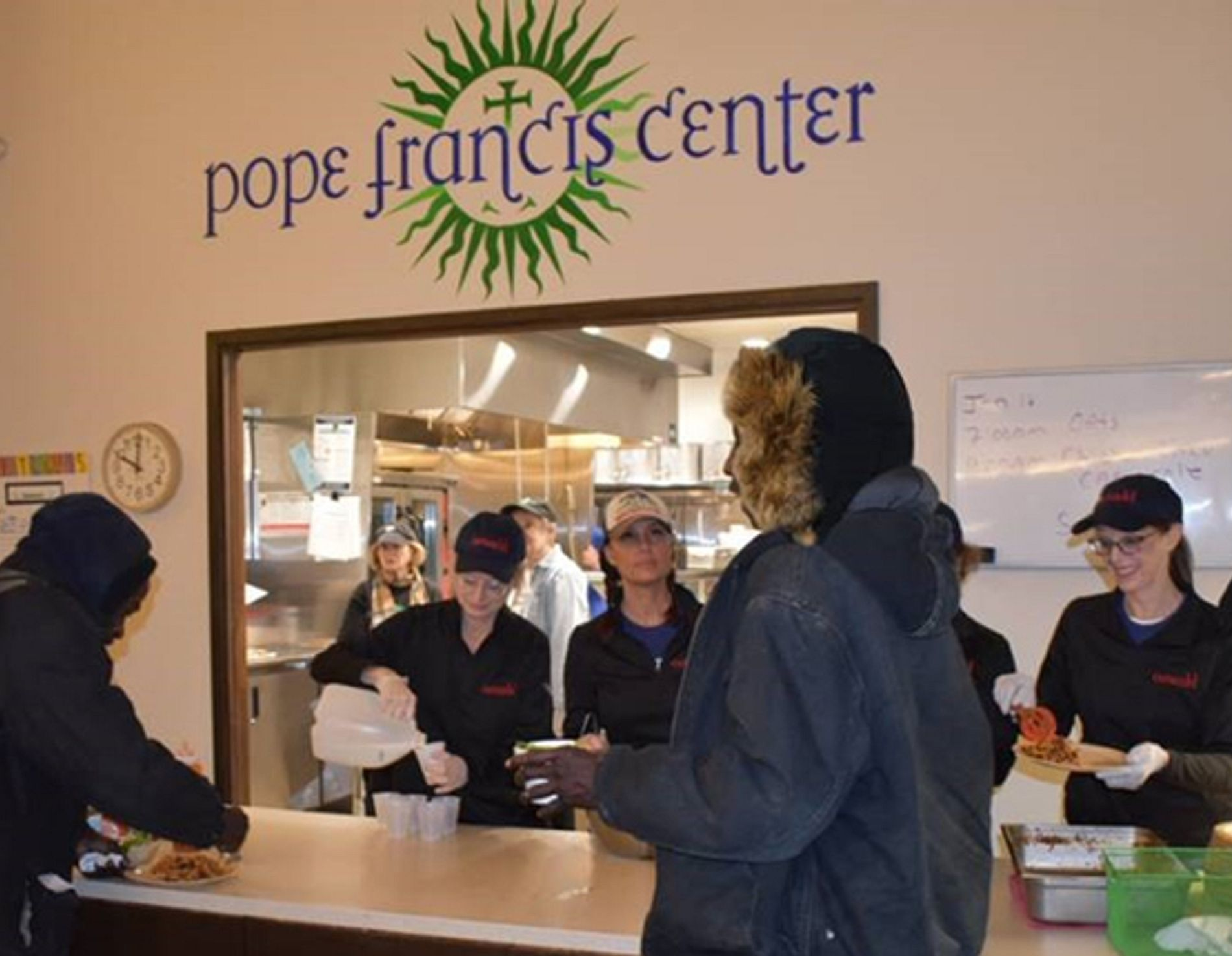 People helping at the Pope Francis Center