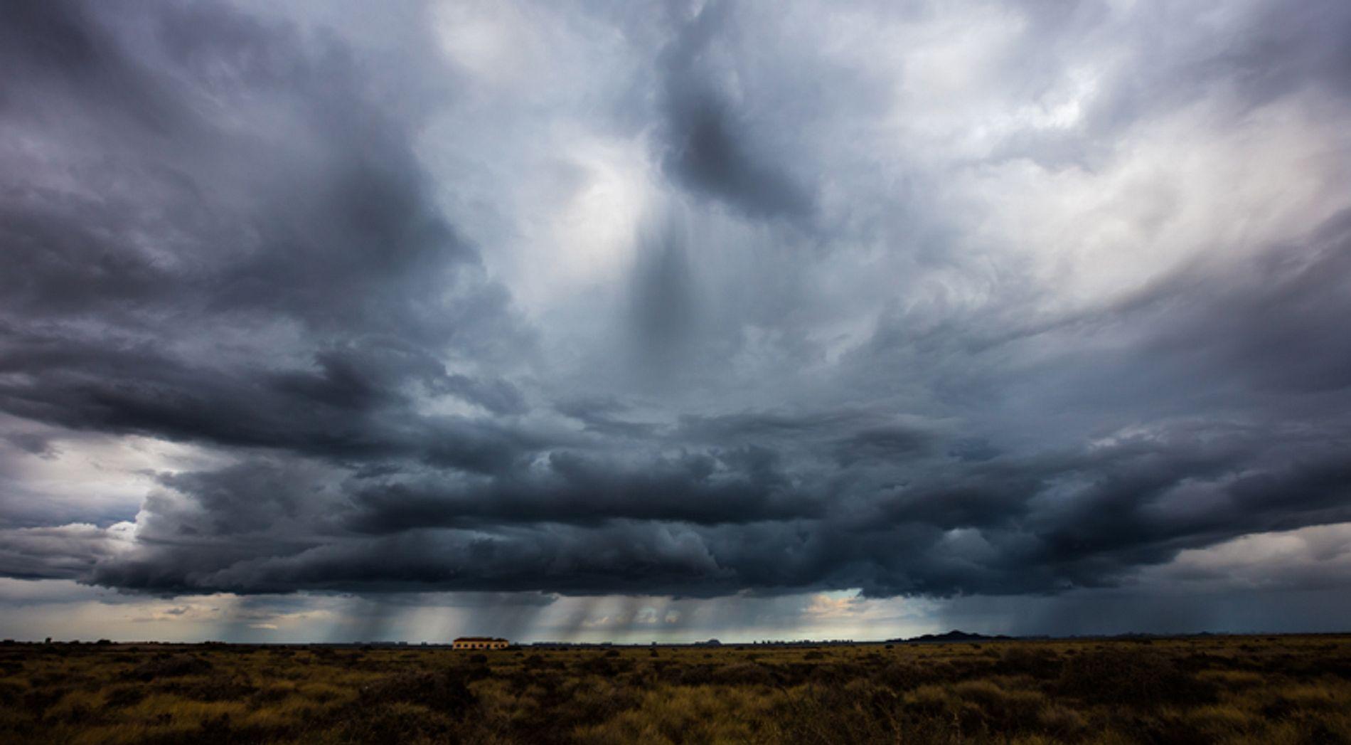Gloomy sky over field