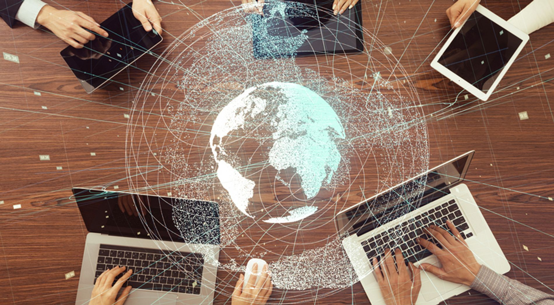 computers in a circle and a holographic globe
