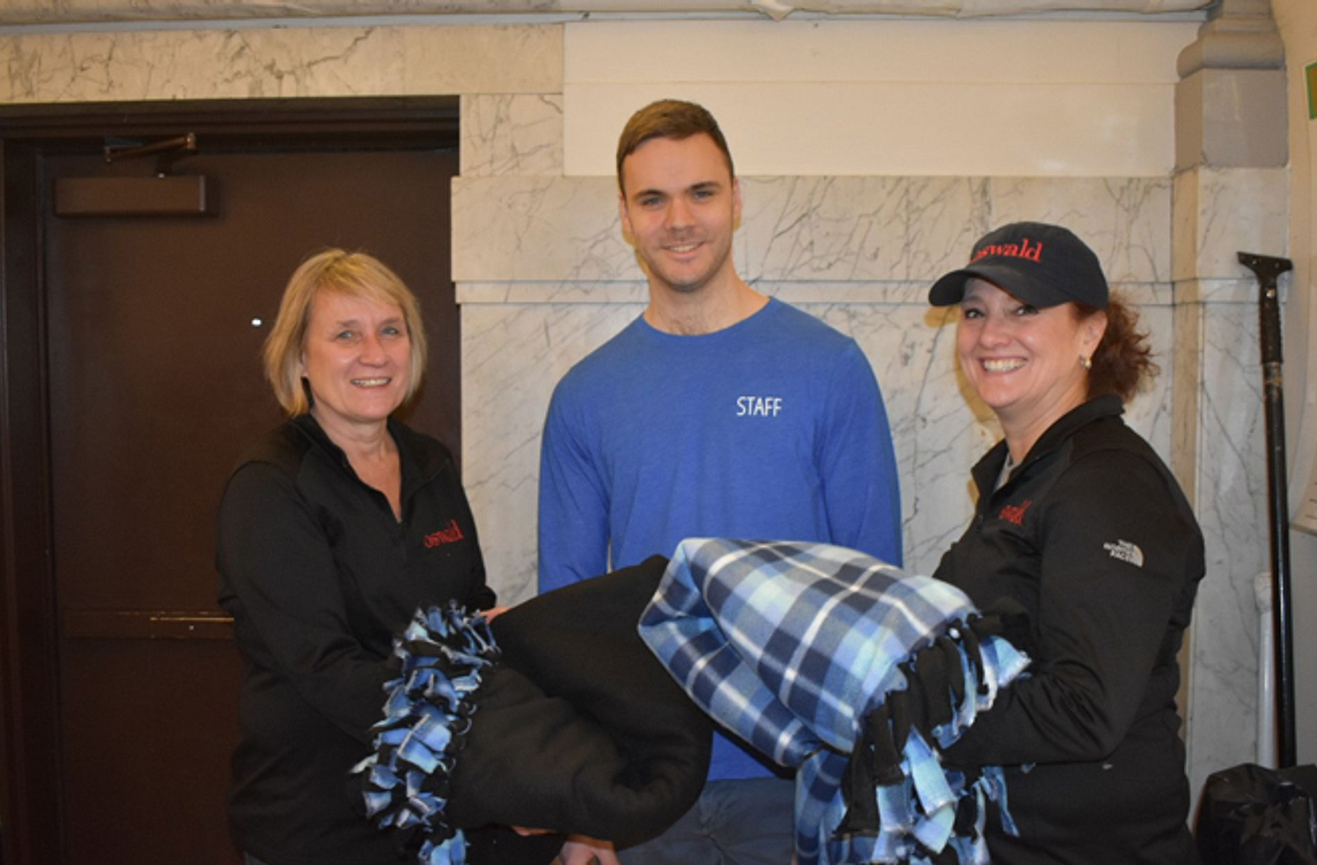 Oswald employee-owners with blanket donations