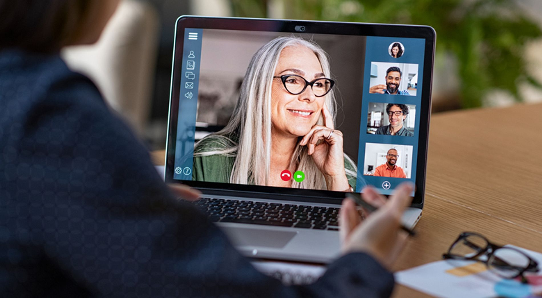 Business team having discussion in video call