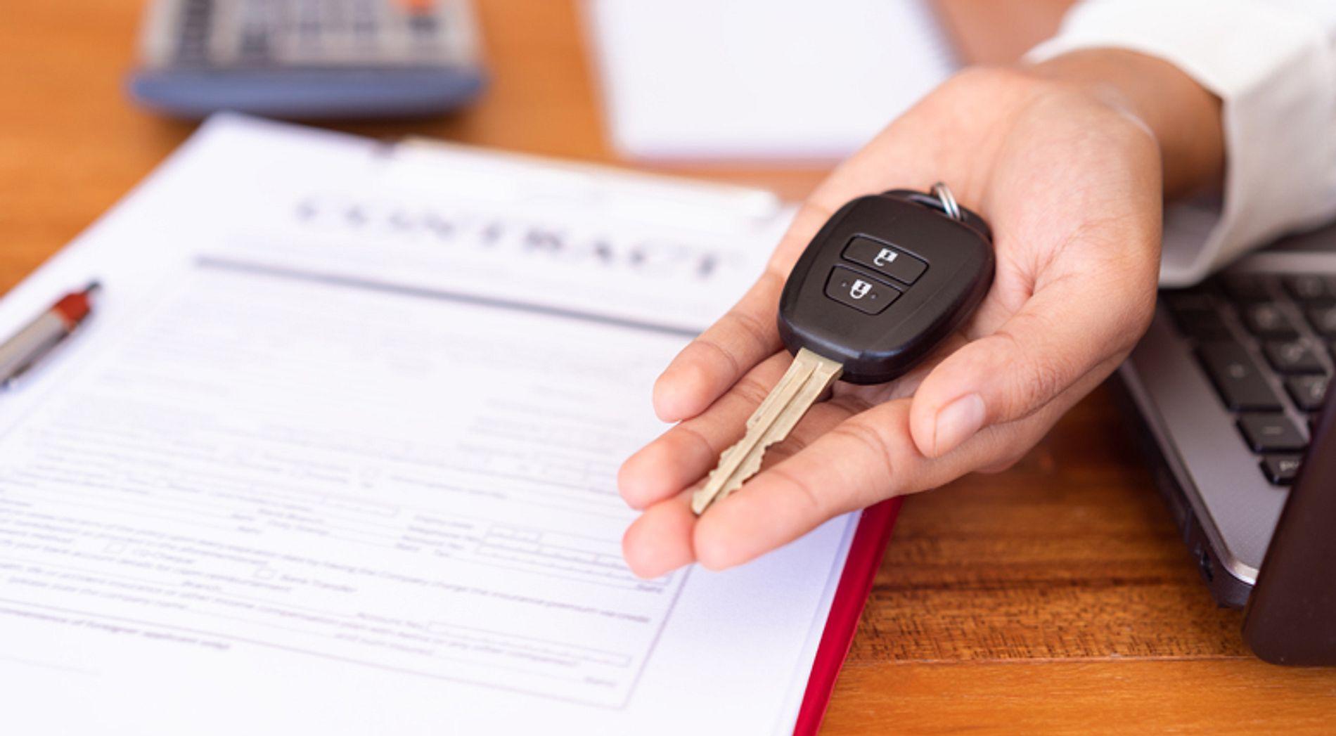 holding car keys