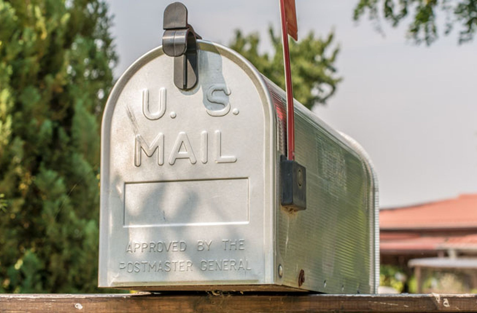 US mailbox from the front with upright flag