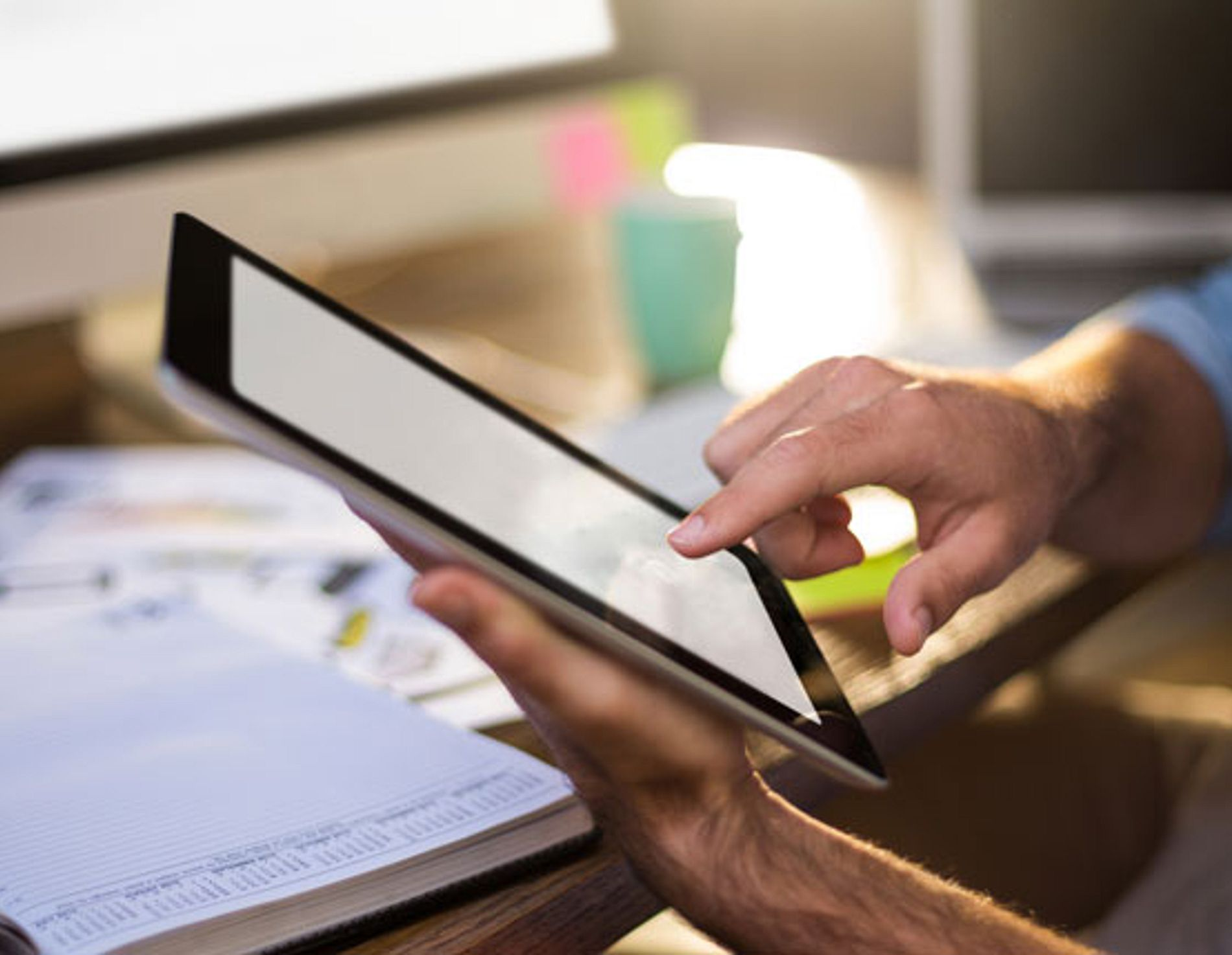 Cropped image of businessman using digital tablet