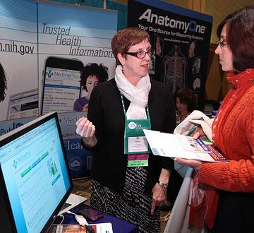 An attendee speaks with an exhibitor during the Forum.