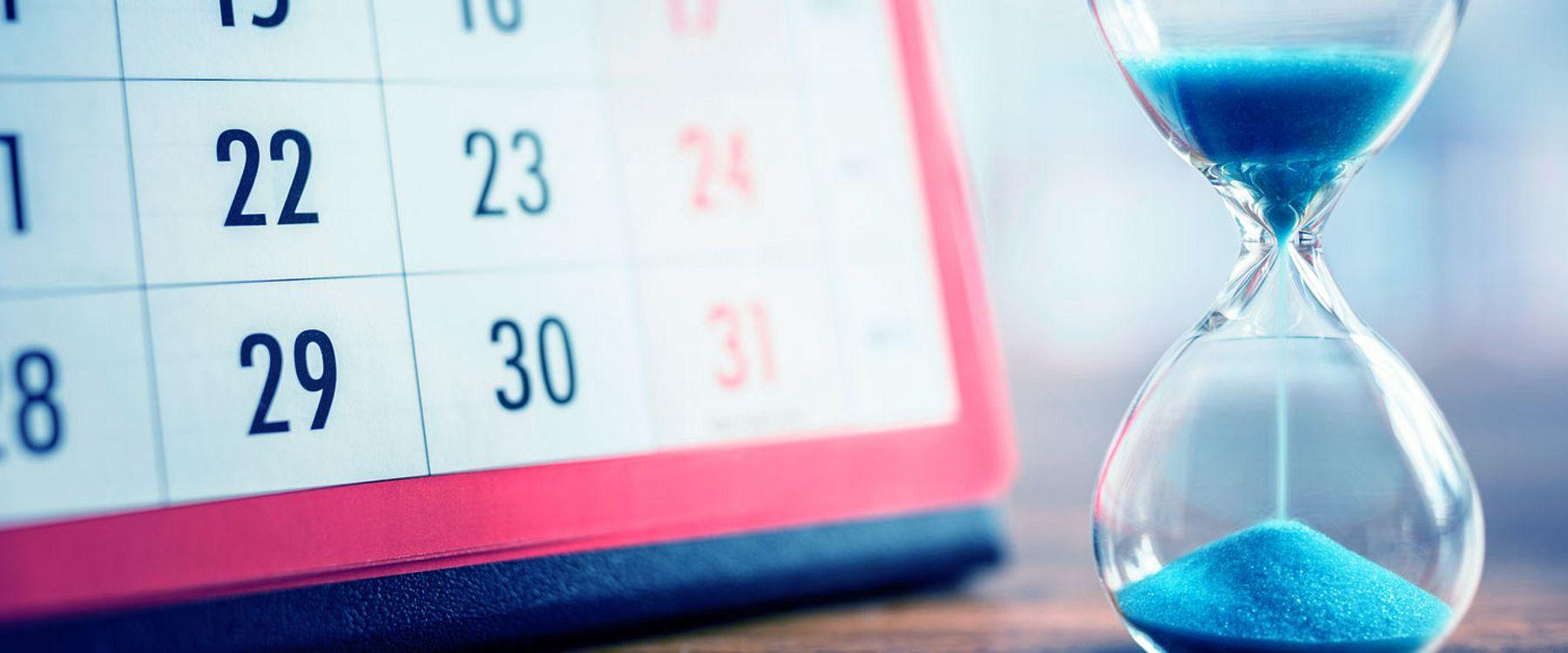 hourglass next to a calendar