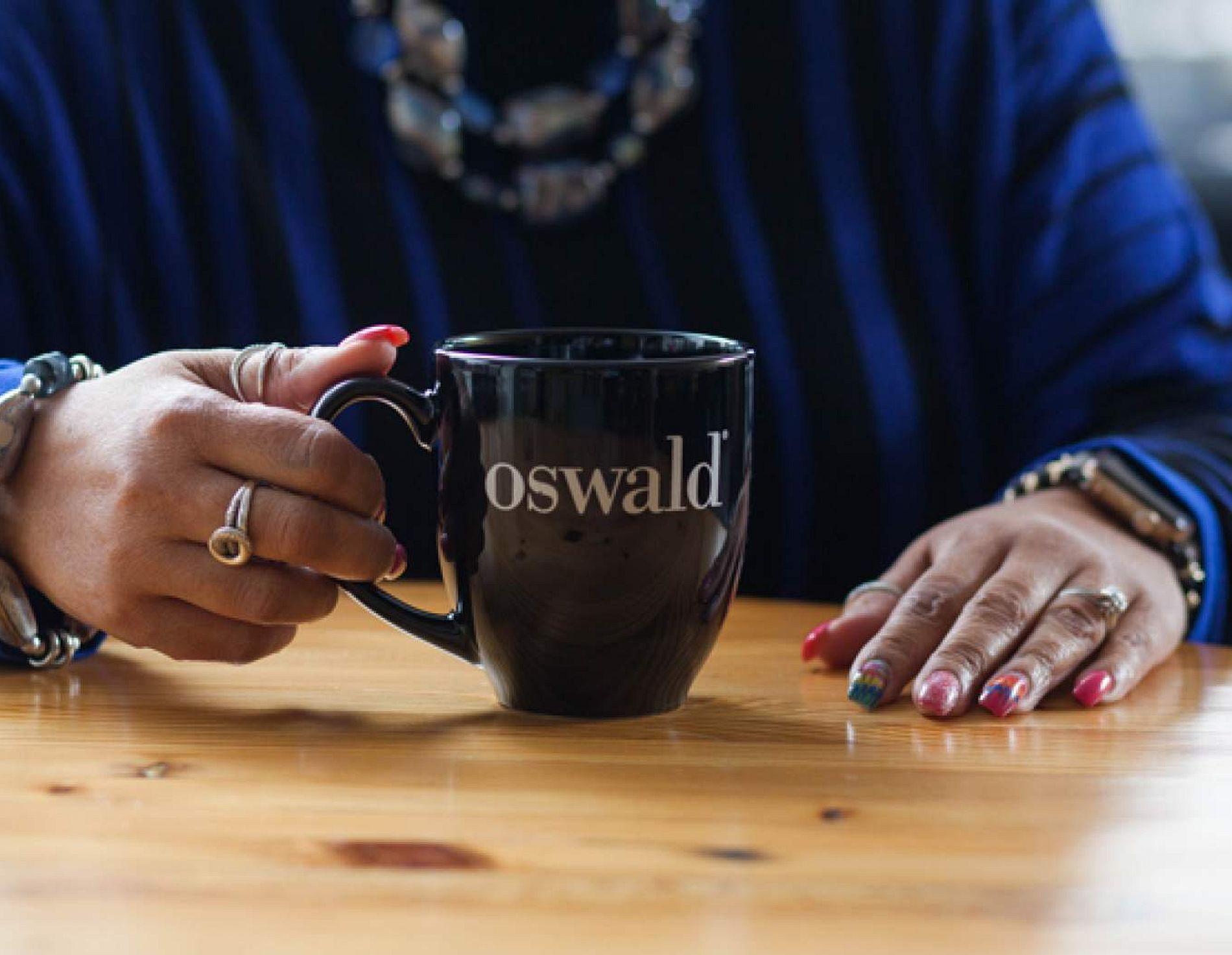 Woman holding a Oswald coffee mug